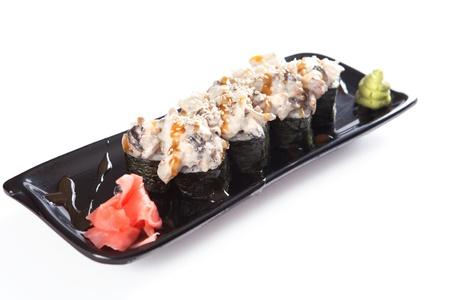 Platter of sushi rolls over white background photo