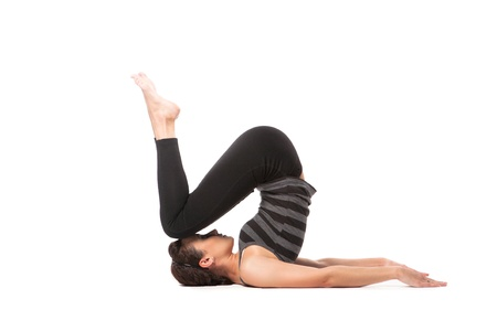 knee bend: Woman practicing yoga isolated over white background Stock Photo