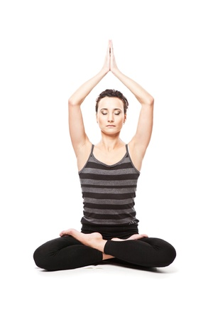 Asian woman is meditating. Yoga practice over white background photo
