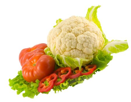 the still life from tomatoes, pepper, cauliflower and salad photo