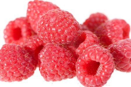 pile of raspberries with water drops macro photo