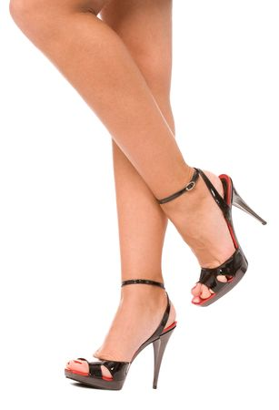 high heel shoes: female legs in high heel shoes isolated on a white Stock Photo