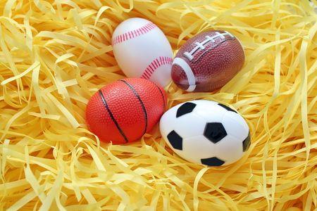 Fake easter egg. Sport Ball in the nest. photo