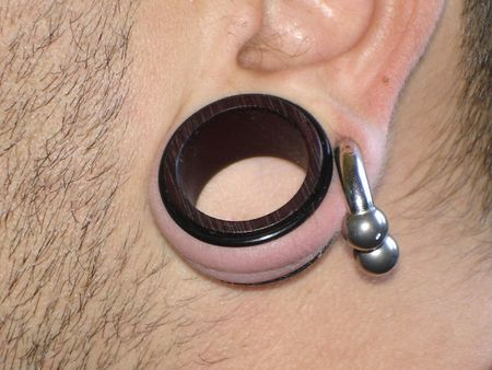 piercing: Stretched Ear                               Stock Photo
