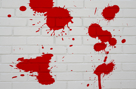 regular:  White Brick wall with blood. Stock Photo
