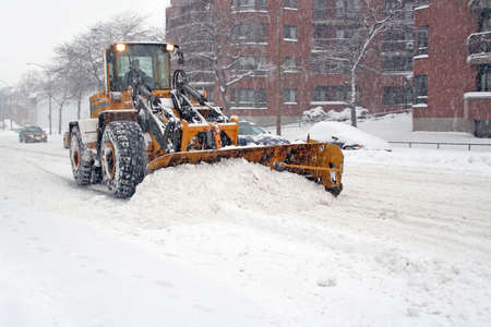 plows: Truck with shovel remove snow.