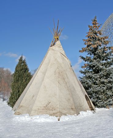 teepee: Traditionnal teepee in snow. Stock Photo