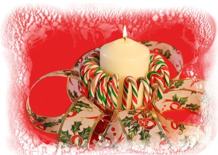 Christmas candle and candy cane with snow around. photo