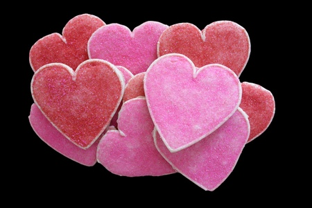 Heart-shaped biscuits for Valentine's Day on black background. Stock Photo - 9054862