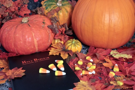 Happy Thanksgiving with Holy Bible and pumpkins . photo