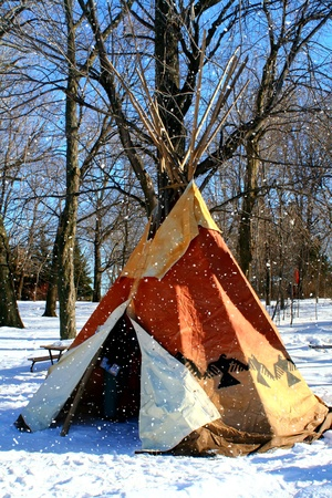 tepee:  A traditional North-American Indian tepee in the snow. Stock Photo