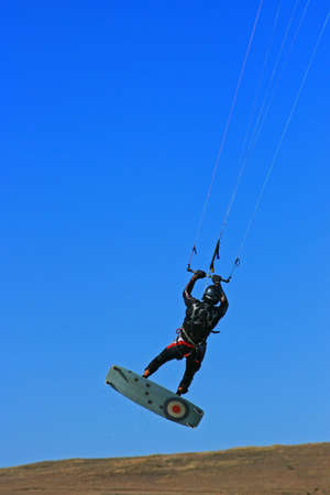 kiter: A kiter with blue sky background slightly above ground Stock Photo