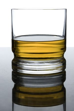 overexposed: whisky on black granite with overexposed background