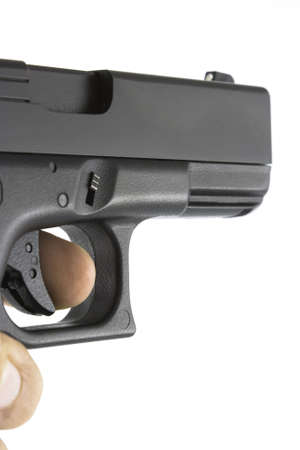 finger on trigger: Handgun being aimed with finger on trigger. Gun angled for semi side view to show along length of gun Stock Photo
