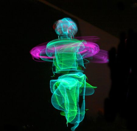 fiberoptic: A dancer wearing fiber-optic lights spinning in the dark, creating a bright whirpool of colors