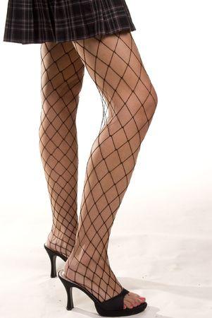 bas r�sille: Sexy fishnet stockings et les jambes. Encadr�e par une courte minijupe plaid.