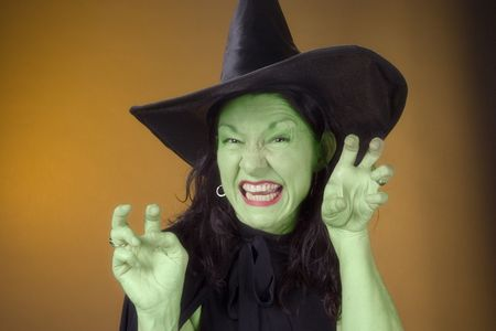 crone: dark hair witch in costume Stock Photo