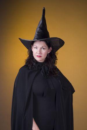 beldam: dark hair witch in costume Stock Photo