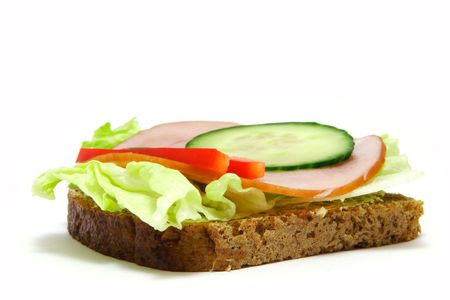 Toastsandwich with lettuce, ham, cucamber and paprika.