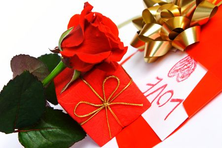 roseleaf: Red rose, red gift and red envelope with love letter.