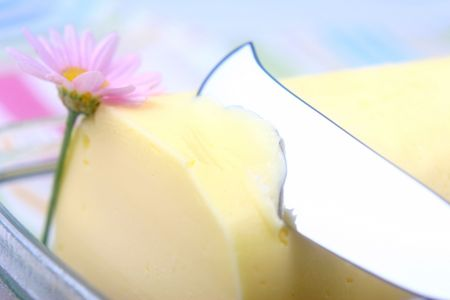 calorific: Butter and butter knife with pink flower.