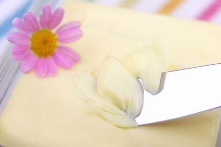 Butter and butter knife with pink flower. photo