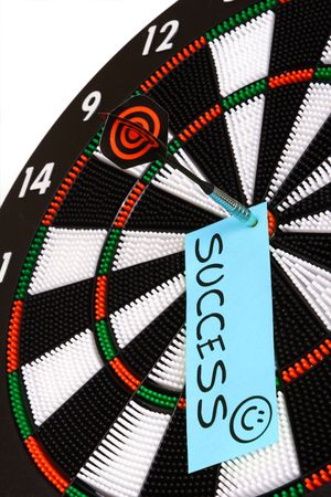 Dartboard. Hitting the mark and achieving success. Stock Photo