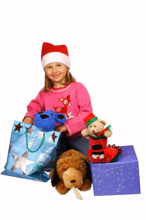 Girl in red Santa Claus with presents.  Stock Photo