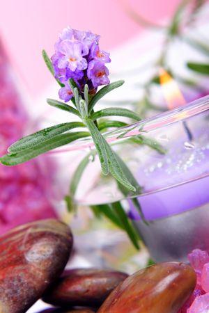 Elements of lavender SPA: fresh lavender, lavender candle. lavender salt and polished stones. Stock Photo