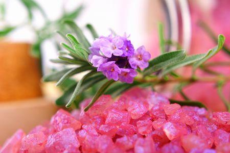 Bottle of lavender mineral salt with fresh lavender.