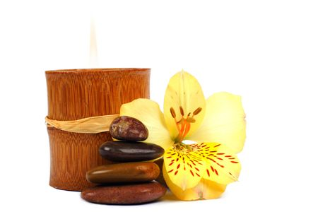 Composition of SPA elements: stone cairn, bamboo candle and flower. Stock Photo - 625514