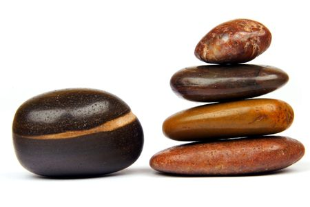 SPA elements: polished stones cairn and a single stone. Stock Photo - 625517