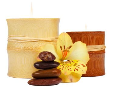 Composition of SPA elements: stone cairn, bamboo candle and flower. Stock Photo