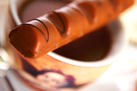Cup of hot chocolate with chocolate bar. Stock Photo