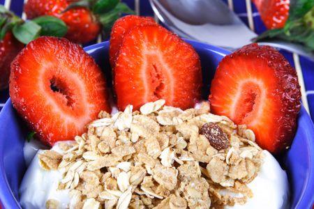 musli: Healthy breakfast: musli with yoghurt and strawberries.