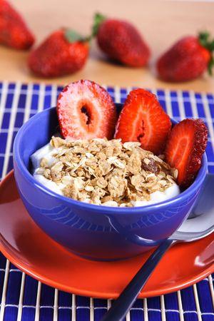 Healthy breakfast: musli with yoghurt and strawberries.