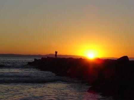 Kiss at sunset Stock Photo - 360272