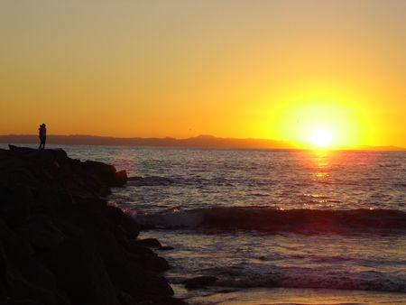 composure: Couple at the beach, sunset, California Stock Photo