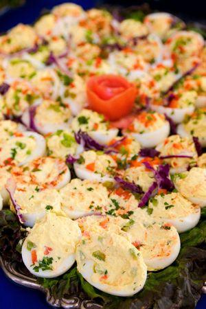 deviled eggs: A large platter of deviled eggs