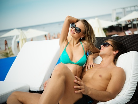 attractive person: Sexy young couple relaxing on a beach bed