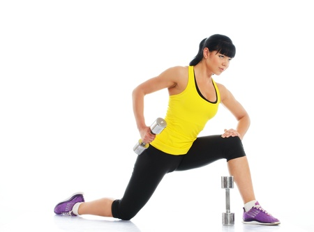 Beautiful girl doing fitness exercise with dumbbells  photo