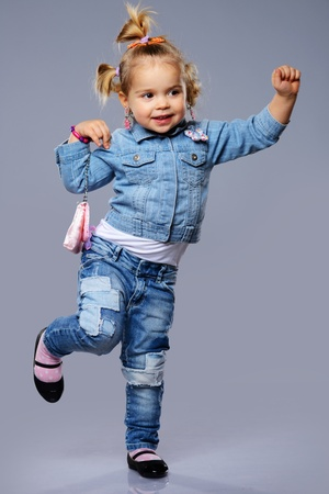 Funny little girl with small bag photo