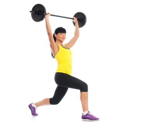 exertion: Beautiful fitness girl liftings weights isolated on white background