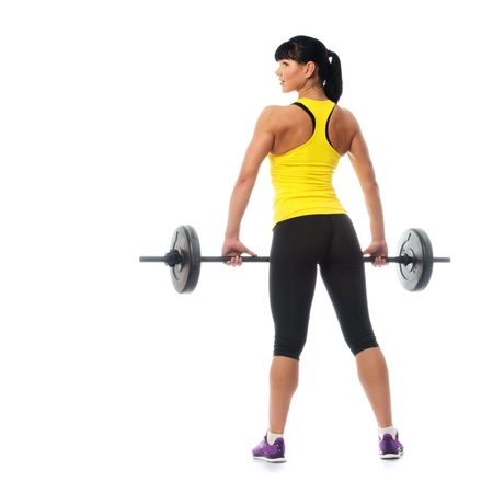 Beautiful fitness girl liftings weights isolated on white background  photo