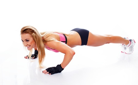 pushup: Sporty woman doing push-up on white background Stock Photo