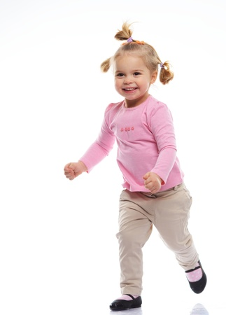 knitted jacket: Happy little girl in pink knitted jacket isolated on white