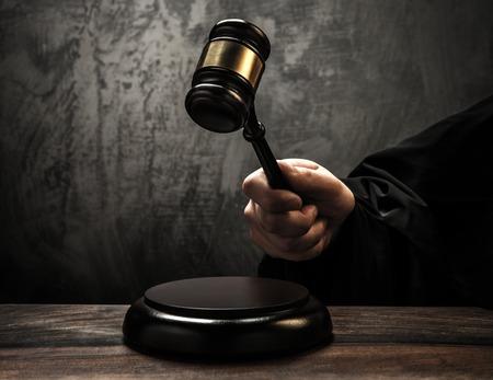 verdict: Judges holding wooden hammer