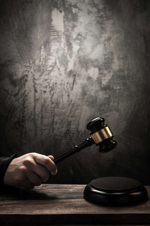 justice court: Judges holding wooden hammer