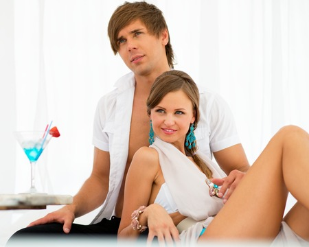 Sexy young couple relaxing under summer awning  Stock Photo - 22385309