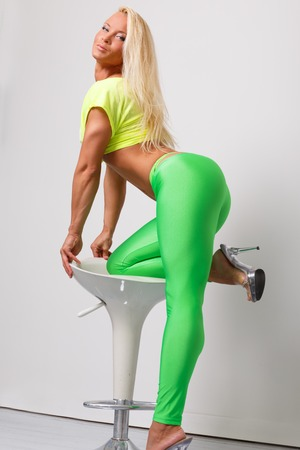 Sexy blond sporty woman in green leggings  photo